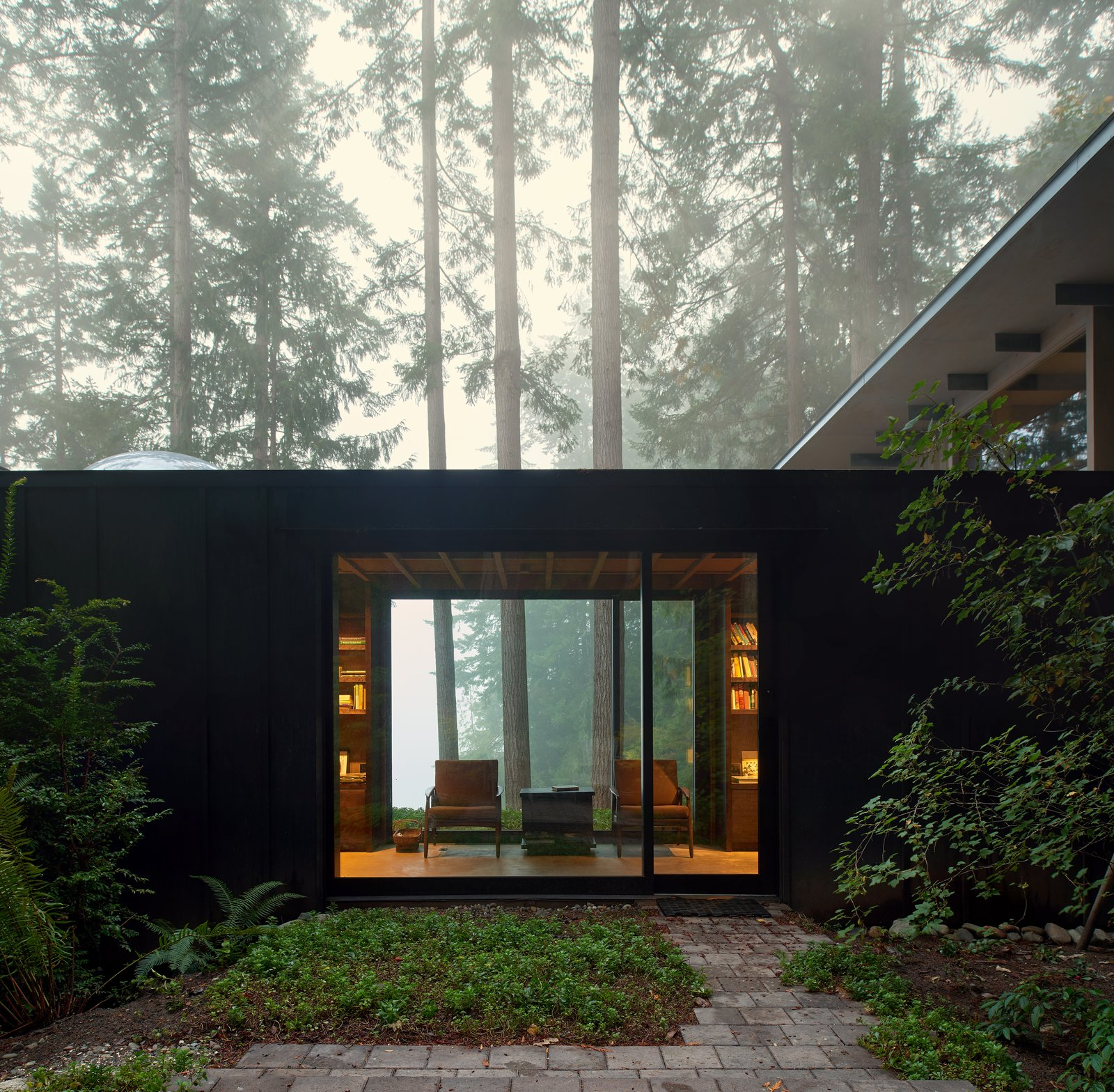 the-cabin-is-intentionally-subdued-in-color-and-texture-allowing-it-to-recede-into-the-woods-and-defer-to-the-beauty-of-the-landscape.jpg