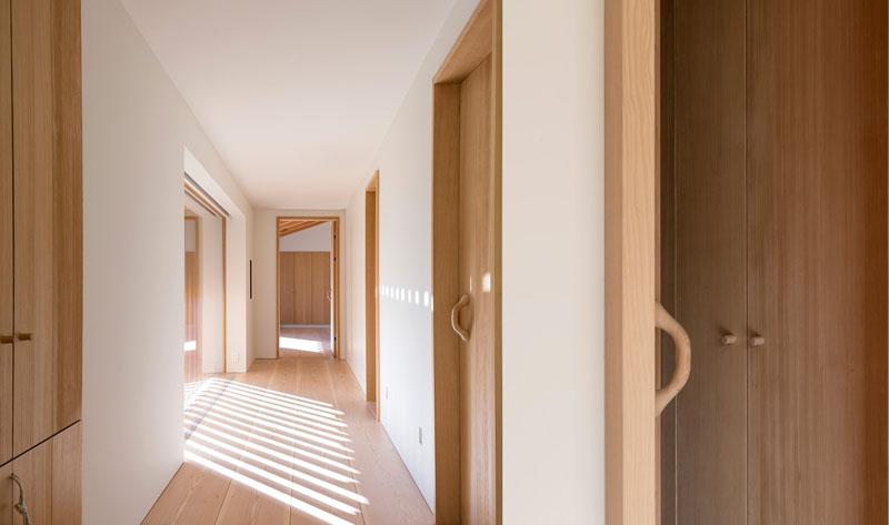 white-hallway-light-wood-doors-060417-141-11.jpg